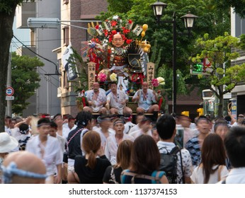 Fukuoka city Fukuoka prefecture JAPAN - July 10 2018: Summer festival with men racing through the streets while bearing 1-ton floats on their shoulders. They start to run. Hakata Gion Yamakasa. From J