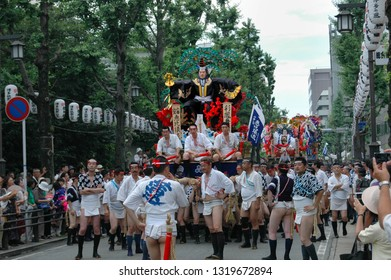 Fukuoka city Fukuoka prefecture JAPAN - July 12 2008: Summer festival with men racing through the streets while bearing 1-ton floats on their shoulders. Hakata Gion Yamakasa. From July 1st to 15th.