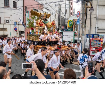 Fukuoka city Fukuoka prefecture JAPAN - July 14 2019: Summer festival with men racing through the streets. Float is turn to the corner. Hakata Gion Yamakasa. From July 1st to 15th.