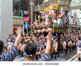 Fukuoka city Fukuoka prefecture JAPAN - July 14 2019: Summer festival with men racing through the streets while bearing 1-ton floats on their shoulders. Hakata Gion Yamakasa. From July 1st to 15th.