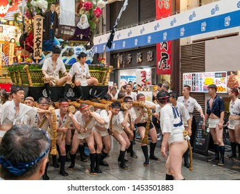 Fukuoka city Fukuoka prefecture JAPAN - July 14 2019: Summer festival with men racing through the streets while bearing 1-ton floats on their shoulders. Float ready to start. Hakata Gion Yamakasa. Fro