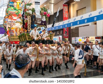 Fukuoka city Fukuoka prefecture JAPAN - July 14 2019: Summer festival with men racing through the streets while bearing 1-ton floats on their shoulders. start to run. Hakata Gion Yamakasa. From July 1