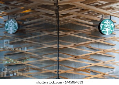 Fukuoka, Japan - April 30, 2019 : Starbucks with reflection of glass window, near the entrance stone torii gate at Dazaifu Tenmangu Shrine.