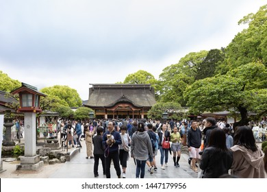 Fukuoka, Japan - April 30, 2019 : A crowd of tourists visiting Dazaifu Tenmangu Shrine at day before the transition from Heisei to Reiwa.