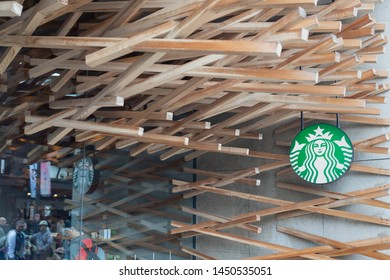 Fukuoka, Japan - April 30, 2019 : Starbucks near the entrance stone torii gate at Dazaifu Tenmangu Shrine.