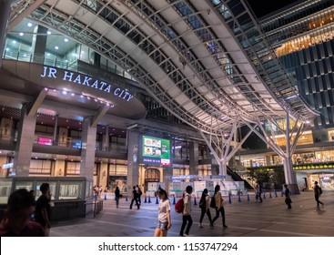FUKUOKA, JAPAN - AUGUST 4TH, 2018. Pedestrian at Japan Railway Hakata Station building at night.