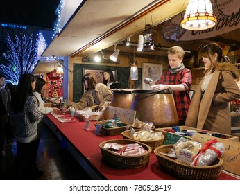 FUKUOKA, JAPAN - December 24, 2017: Temporary hot wine booth is opened at Christmas Market, in front of JR Hakata station during Christmas and New Year holiday season.