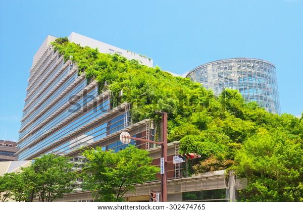 FUKUOKA, JAPAN - JUL 09: View of Acros Fukuoka on Jul 09, 2015 in Fukuoka, Japan. Acros Fukuoka is the eco-building and landmark of Fukuoka that has a green roof.