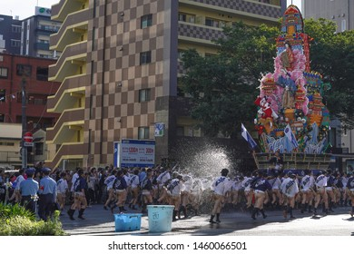 Fukuoka, Japan - July 12, 2019: Participants carrying a decoration float during Oiyamanarashi which is a rehearsal race before the actual event during Hakata Gion Yamakasa