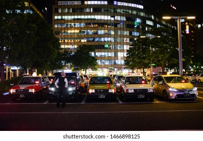 Fukuoka, Japan, July 31st 2019 : Line of taxis in front of JR Hakata City Station.