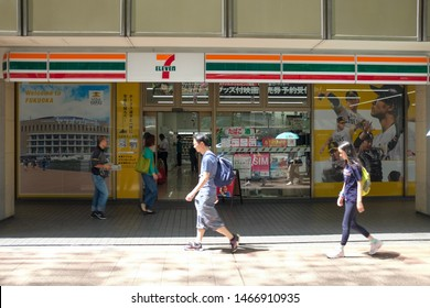 Fukuoka, Japan, July 31st 2019 : People walk past the 7-Eleven store