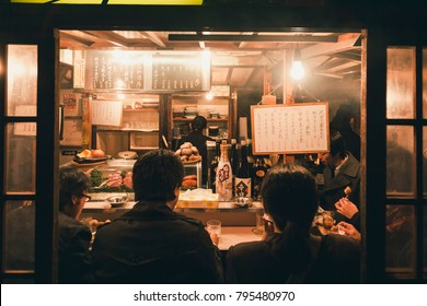 FUKUOKA, JAPAN - MAR 3, 2012 : Yatai Fukuoka's open air food stands Ramen shop with crowd people city nightlife