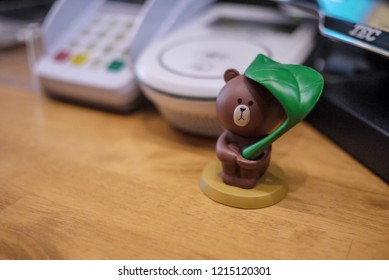 "Fukuoka, Japan - May 27 2017: The most favorite character of LINE Corp. the toy bear called ""Brown"" place on LINE CAFE cashier counter, Fukuoka, Japan"