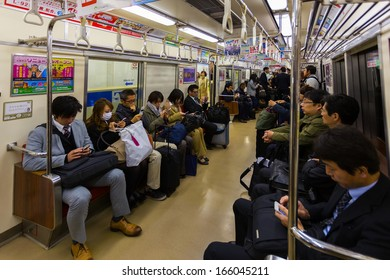 FUKUOKA, JAPAN - NOVEMBER 13: Train commuters in Fukuoka, Japan on November 13, 2013. Connected the city and Fukuoka airport, people can also use JR or subway for transportation in and out of the city