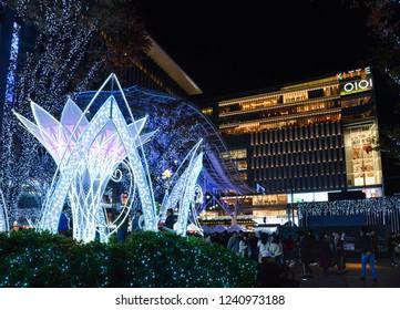 Fukuoka, Japan- November 18, 2018: Many people visit the light up in front of JR Hakata city, Fukuoka, Japan