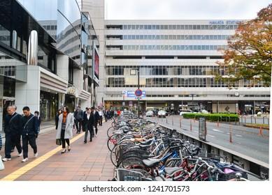 Fukuoka, Japan- November 19, 2018: Many people are walking out of Hakata station to work in the morning,  Fukuoka, Japan