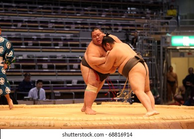 FUKUOKA, JAPAN - NOVEMBER 19: Two young sumo wrestlers in a tight grip in the arena of the Fukuoka Tournament on November 19, 2010 in Fukuoka, Japan.