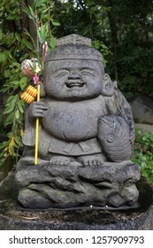 Fukuoka, Japan - October 19, 2018: Stone Ebisu statue, the Japanese god of fishermen and luck, he is one of the Seven Gods of Fortune
