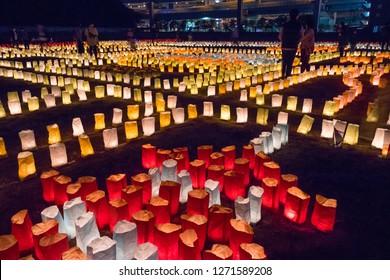 Fukuoka, Japan - October 20, 2018: Illuminated colorful paper lanterns for the Hakata Tomyo Watching festival at the Tochoji temple grounds at night
