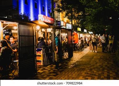 FUKUOKA, JAPAN - SEPTEMBER 26, 2016: People eating Yatai mobile food stall at night in Fukuoka, Kyushu, Japan