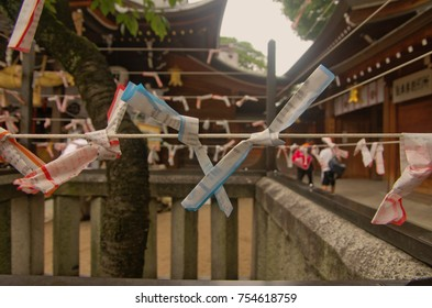 Fukuoka,Kyushu,Japan. - May 16th,2015 : A random fortune telling ticket call in Japanese is Omikuji that strips of paper available in English, Korean, Chinese and Taiwanese languages in Kushida shrine