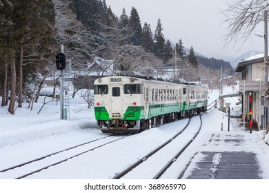 FUKUSHIMA, JAPAN - MARCH 15: The local train at Aizu-Miyashita station on March 15 , 2014 in Fukushima , Japan. This train services in East Japan railway company's Tadami line.
