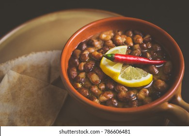 Ful Medames - is an Egyptian dish of cooked Fava beans served with vegetable oil, lemon, chili. It is a popular traditional/oriental food in Egypt and all middle east.