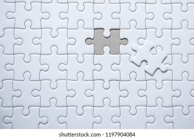 Fulfill the last piece of jigsaw puzzle to complete.,Empty jigsaw puzzle.