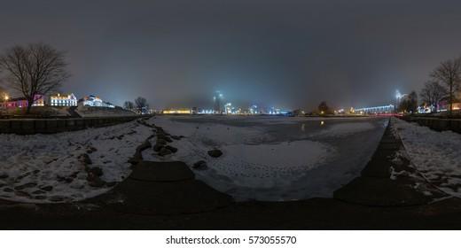 Full 360 degree equirectangula panorama night quay in the winter