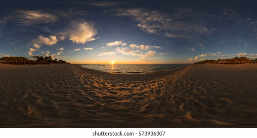 Full 360 degree equirectangula panorama sunset by the sea on the beach