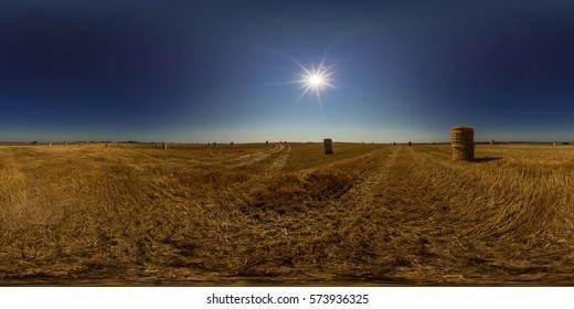 Full 360 degree equirectangula panorama field with straw bales