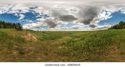 full 360 degree seamless panorama in equirectangular spherical equidistant projection. Panorama view  in a field in beautiful day with nice clouds. Skybox as background for virtual reality content