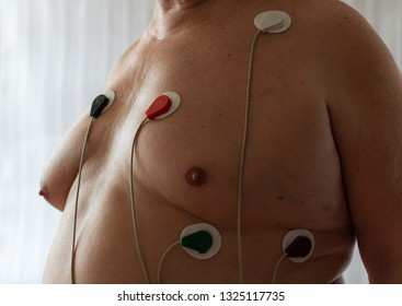 Full aged man with holter sensors