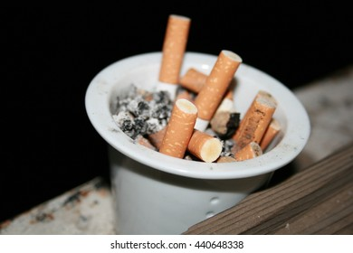 full ashtray of cigarettes