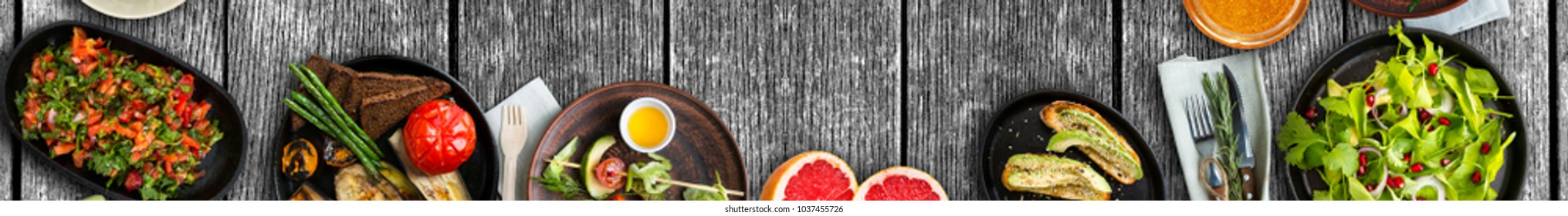 Full banner, wide food background, vegetarian meal and healthy products on rustic wooden table, wide panoramic image. Copy space.