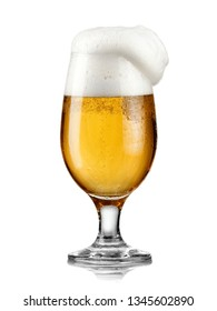 Full beer glass with froth overflow