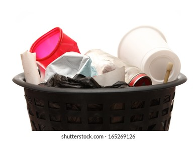 Full black wastebasket on white