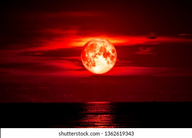 full blood moon on sea and ocean light sky silhouette cloud, Elements of this image furnished by NASA