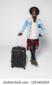 Full body of African american business man traveling with suitcases walking.