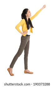 Full body Asian woman standing with hand raised high grabbing something, isolated on white background.
