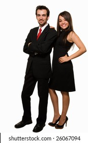 Full body of an attractive brunette woman wearing black formal dress and man in suit and red tie standing beside each other over white