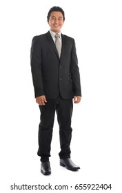 Full body attractive young Southeast Asian businessman standing isolated on white background. Asian malay male model.