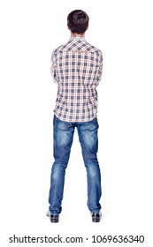 Full body back view portrait of smiling young man with crossed arms on his chest wearing metal frame glasses, checkered shirt, blue jeans and black shoes isolated on white background