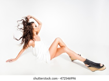 full body of beautiful woman model posing in white dress in the studio