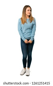 Full body of Blonde woman with blue shirt feeling upset on white background