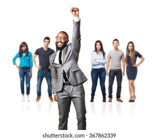 full body business black man doing a winner gesture