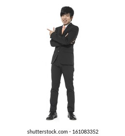 Full body business young man touching an imaginary screen or button on white background