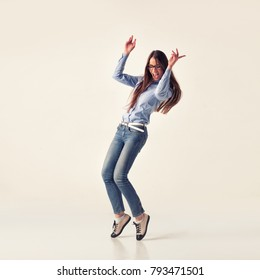 Full body of cheerful beautiful business woman, isolated over light grey studio background