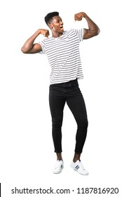 Full body of Dark skinned man with striped shirt celebrating a victory in winner position on white background