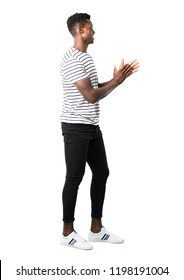 Full body of Dark skinned man with striped shirt smiling and applauding on white background